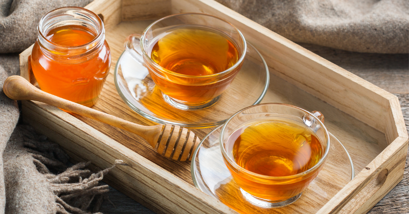 tray with tea and honey